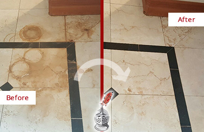 Before and After Picture of a Hitchcock Hard Surface Restoration Service on a Marble Floor to Eliminate Rust Stains